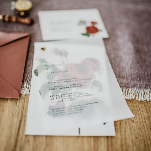 zaproszenie ślubne połączone złotym nitem