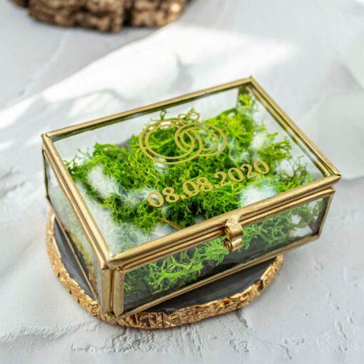 Szklane, złote pudełko na obrączki
